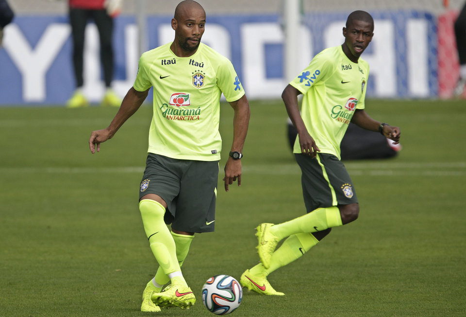 Photo - Brazil's Maicon, left, and Ramires practice during a training session of the Brazilian national soccer team, at the Granja Comary training center in Teresopolis, Brazil, Monday, June 9, 2014. Brazil plays in group A of the 2014 soccer World Cup. (AP Photo/Andre Penner)