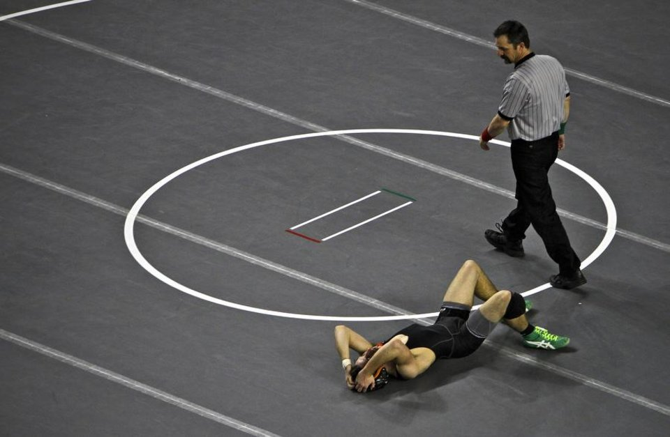 Photo -  HIGH SCHOOL WRESTLING / STATE TOURNAMENT / REACTION: Matt Shepard of Catoosa reacts after a first round loss to Tuttle's Isaac Beard in the in Class 4A 145 pound match during the 90th annual Oklahoma High School state wrestling tournament on Friday, Feb. 25, 2011, in Oklahoma City, Okla.  Photo by Chris Landsberger, The Oklahoman ORG XMIT: KOD