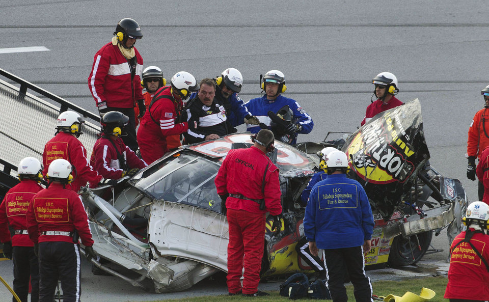 Photo -   Rescue crews pull Mike Affarano (83) from his car after he flipped on the tri-oval during the International Motorsports Hall of Fame 250 ARCA auto race at the Talladega Superspeedway in Talladega, Ala., Friday, May 4, 2012. (AP Photo/Dave Martin)