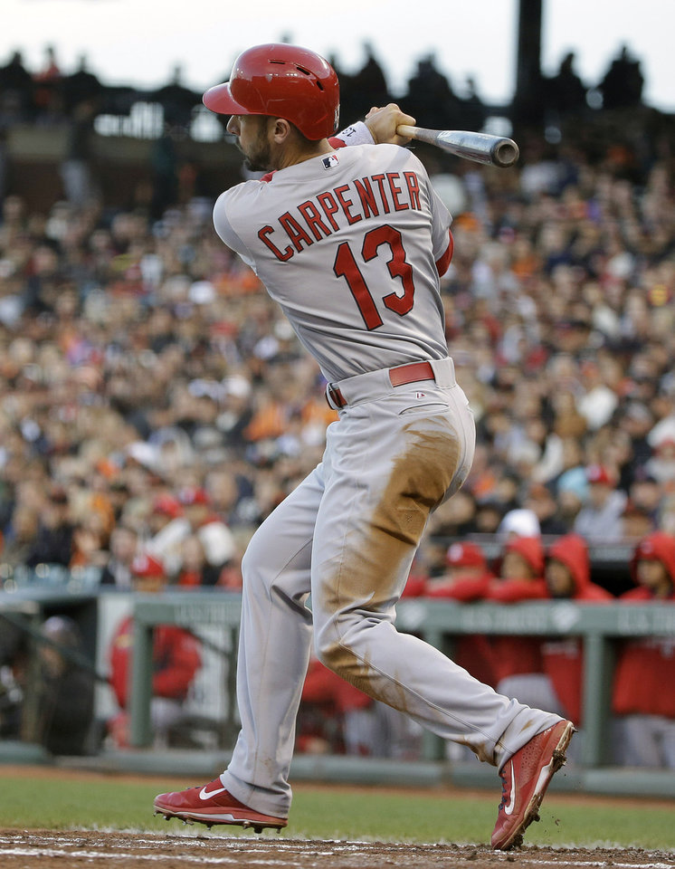 Photo - St. Louis Cardinals' Matt Carpenter hits an RBI single off San Francisco Giants starting pitcher Ryan Vogelsong in the third inning of their baseball game Wednesday, July 2, 2014, in San Francisco. (AP Photo/Eric Risberg)