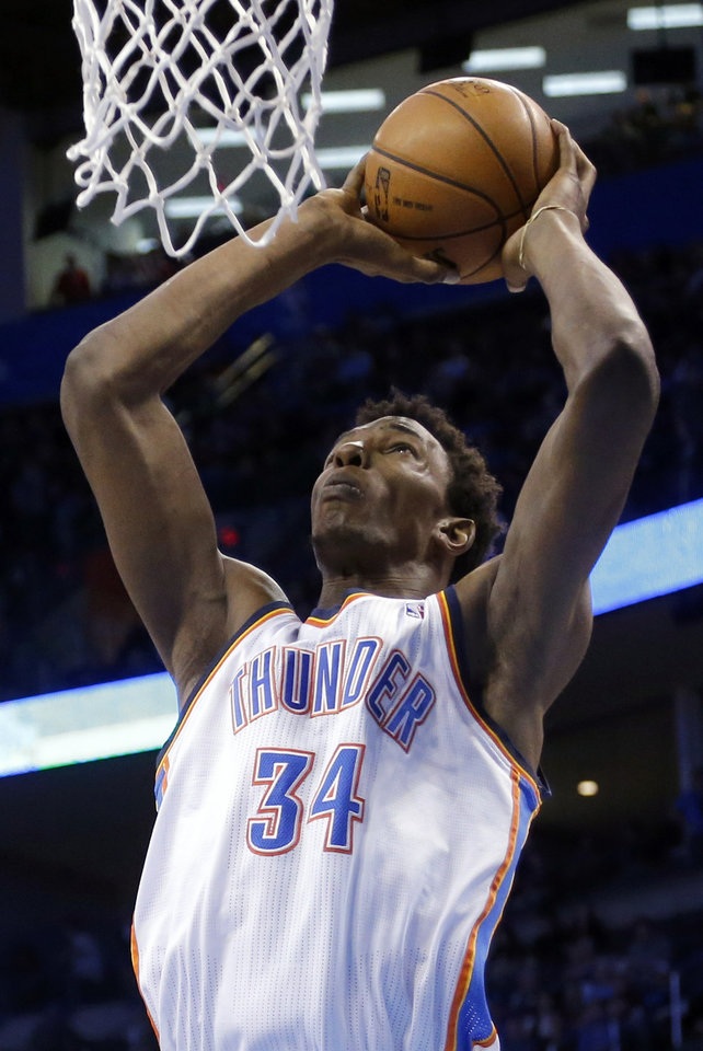 Photo - Oklahoma City's Hasheem Thabeet (34) dunks the ball during the NBA basketball game between the Oklahoma City Thunder and the Memphis Grizzlies at the Chesapeake Energy Arena in Oklahoma City,  Thursday, Jan. 31, 2013.Photo by Sarah Phipps, The Oklahoman
