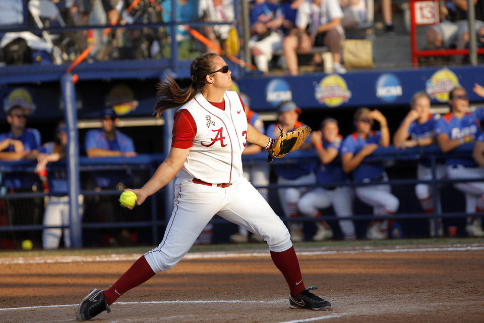 Photo - Alabama's Jackie Traina (33) throws a pitch during the Women's College World Series game between Florida and Alabama at the ASA Hall of Fame Stadium in Oklahoma City, Sunday, June 5, 2011. Photo by Garett Fisbeck, The Oklahoman