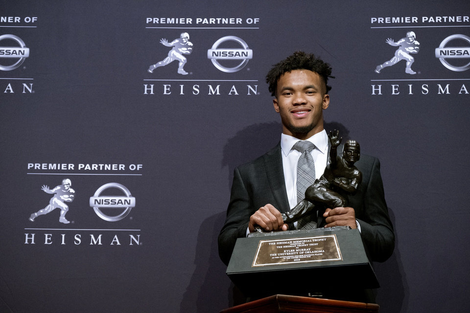 Photo - Oklahoma quarterback Kyler Murray holds the Heisman Trophy after winning the award Saturday, Dec. 8, 2018, in New York. (AP Photo/Craig Ruttle)