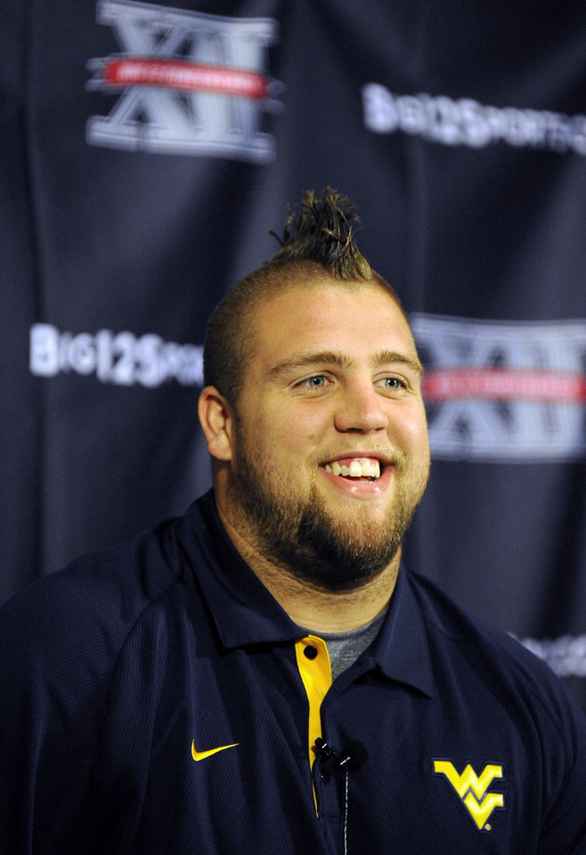 West Virginia center Joe Madsen smiles at NCAA college football Big 12 Media Days, Tuesday, July 24, 2012, in Dallas. (AP Photo/Matt Strasen)