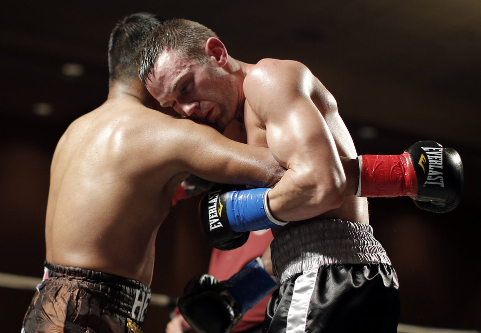 Oklahoma City\'s Noah Zuhdi fights German Jurado, of Panama, for the title of WBU World Lightweight Champion at the Cox Convention Center in Oklahoma City, Thursday, Sept. 20, 2012. Photo by Garett Fisbeck, The Oklahoman