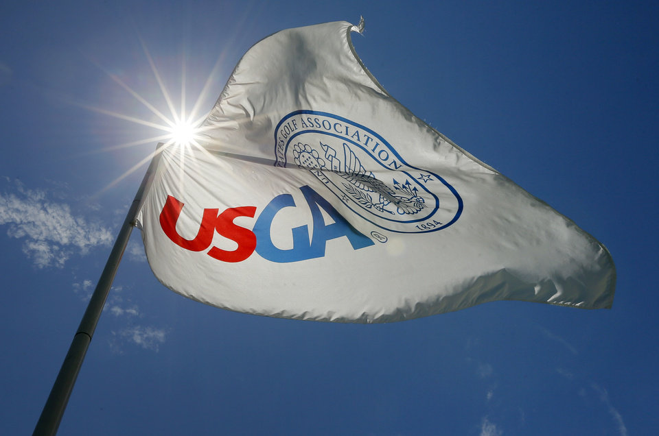 Photo - The USGA flag flies over the No. 18 green during practice rounds for the U.S. Senior Open golf tournament at Oak Tree National in Edmond, Okla., Wednesday, July 9, 2014. Photo by Nate Billings, The Oklahoman