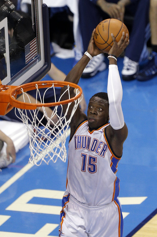 Photo - Oklahoma City's Reggie Jackson (15) dunks the ball during Game 7 in the first round of the NBA playoffs between the Oklahoma City Thunder and the Memphis Grizzlies at Chesapeake Energy Arena in Oklahoma City, Saturday, May 3, 2014. Photo by Sarah Phipps, The Oklahoman