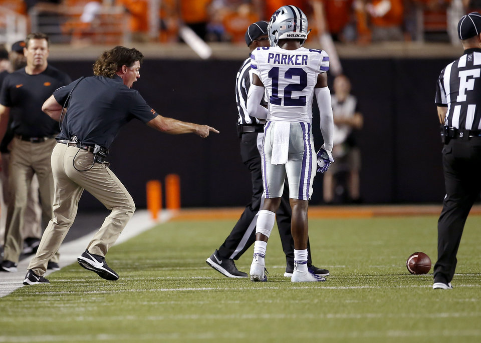 Photo - Oklahoma State head coach points to the spot of the ball in the third quarter during the college football game between the Oklahoma State Cowboys and the Kansas State Wildcats at Boone Pickens Stadium in Stillwater, Okla., Saturday, Sept. 28, 2019. [Sarah Phipps/The Oklahoman]