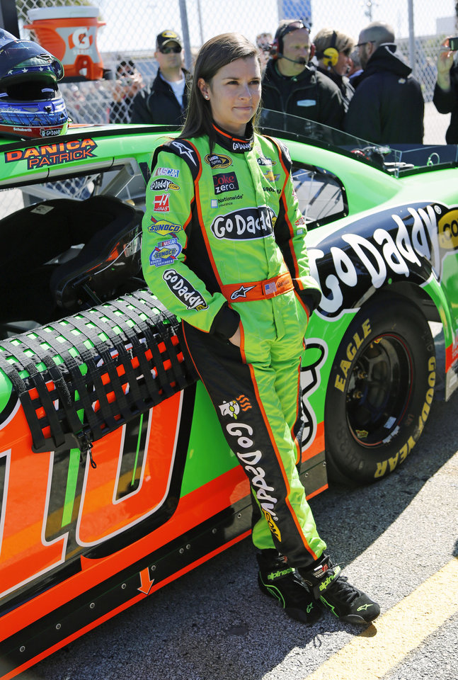 Photo - ADVANCE FOR WEEKEND EDITIONS, FEB. 23-24 - FILE - In this Feb. 17, 2013, file photo, Danica Patrick stands by her car on pit road after qualifying for the NASCAR Daytona 500 Sprint Cup Series auto race at Daytona International Speedway in Daytona Beach, Fla. Patrick became the first woman to win a pole at NASCAR's highest level when she earned the top starting spot for the season-opening Daytona 500 on Sunday, when the new Gen-6 race car will get its first big test. (AP Photo/Terry Renna, File)