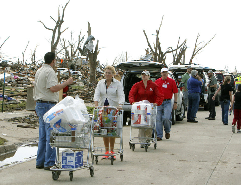 Volunteers walk through the tornado devastated part of Moore, OK, Thursday, May 23, 2013,  Photo by Paul Hellstern, The Oklahoman