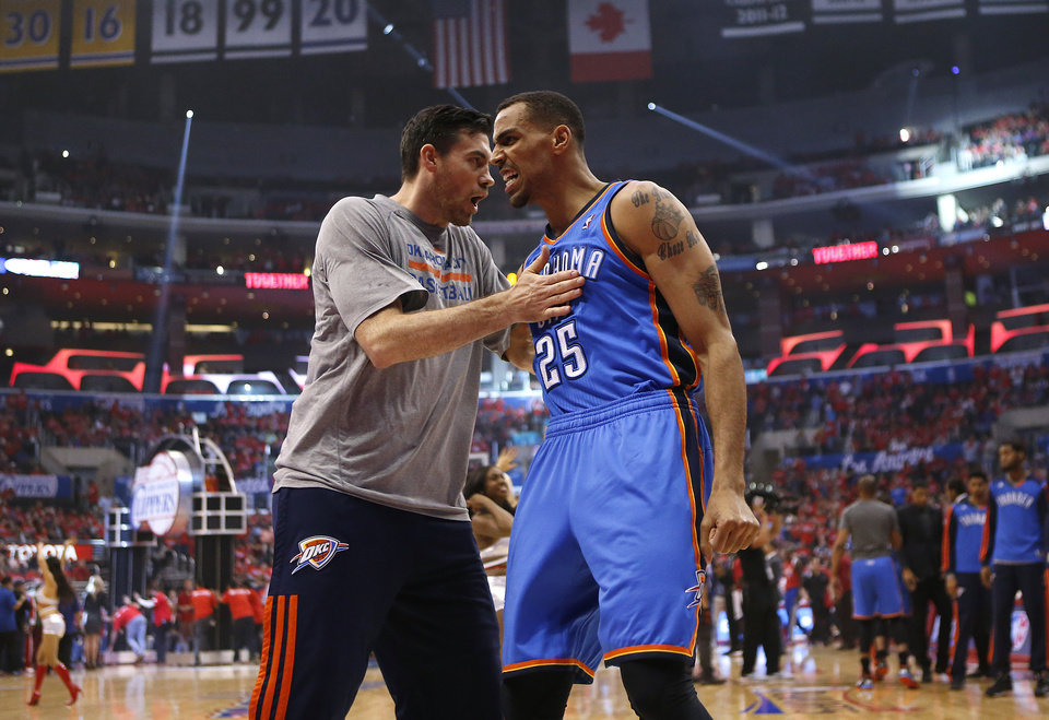Photo - Oklahoma City's Nick Collison (4) and Thabo Sefolosha (25) get ready for Game 3 of the Western Conference semifinals in the NBA playoffs between the Oklahoma City Thunder and the Los Angeles Clippers at the Staples Center in Los Angeles, Friday, May 9, 2014. PHOTO BY NATE BILLINGS, The Oklahoman
