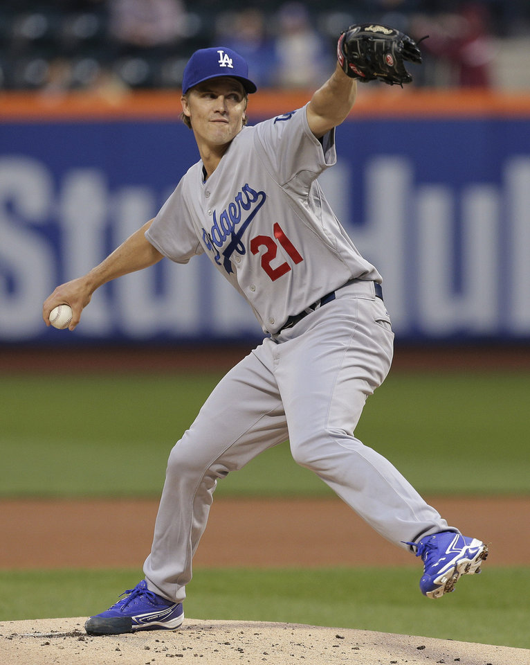 Photo - Los Angeles Dodgers starting pitcher Zack Greinke delivers against the New York Mets during the first inning of a baseball game, Thursday, May 22, 2014, in New York. (AP Photo/Julie Jacobson)