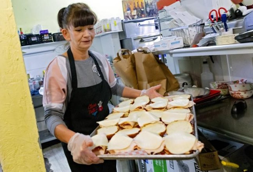 Photo -  Teresa Foster prepares part of the 200 lunches that Clara Belle's restaurant is catering for the staff at Mabel Bassett in McLoud, Okla. on Friday, April 3, 2020. Prison volunteers raised money to pay for lunch boxes for staff at the prison.  [Chris Landsberger/The Oklahoman]