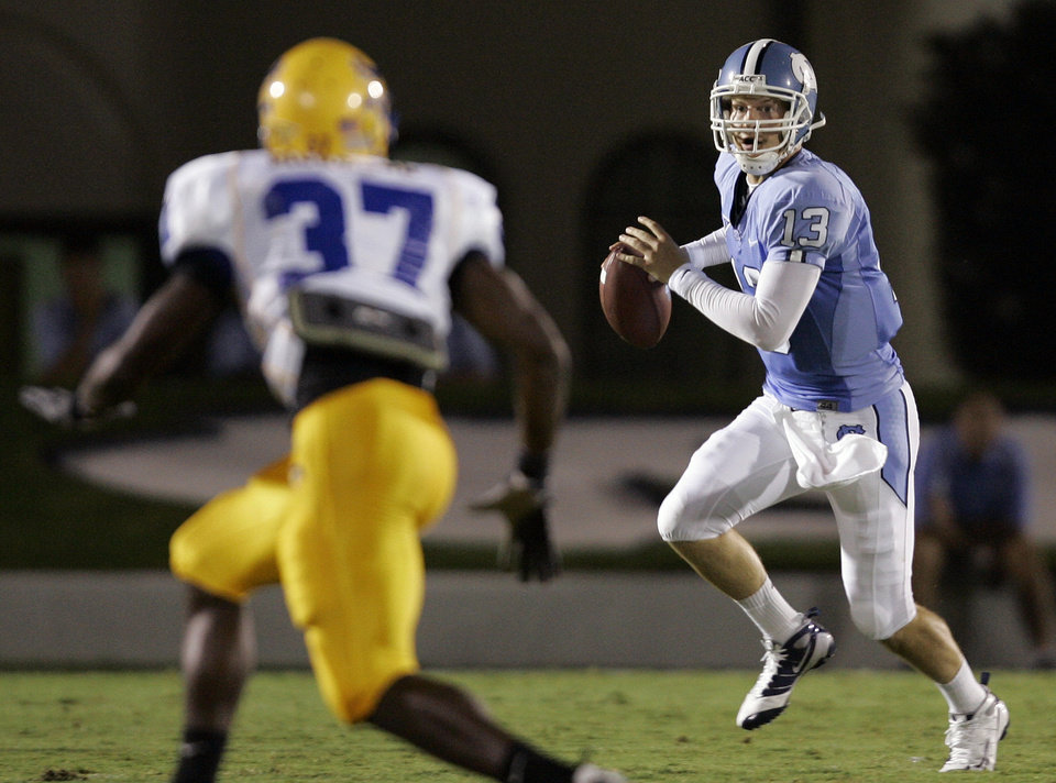 Photo - North Carolina quarterback T.J. Yates (13) looks to pass as McNeese State's Tyson Sibley (37) defends during the second half of a college football game in Chapel Hill, N.C., Saturday, Aug. 30, 2008. North Carolina won 35-27. (AP Photo/Gerry Broome) ORG XMIT: NCGB110