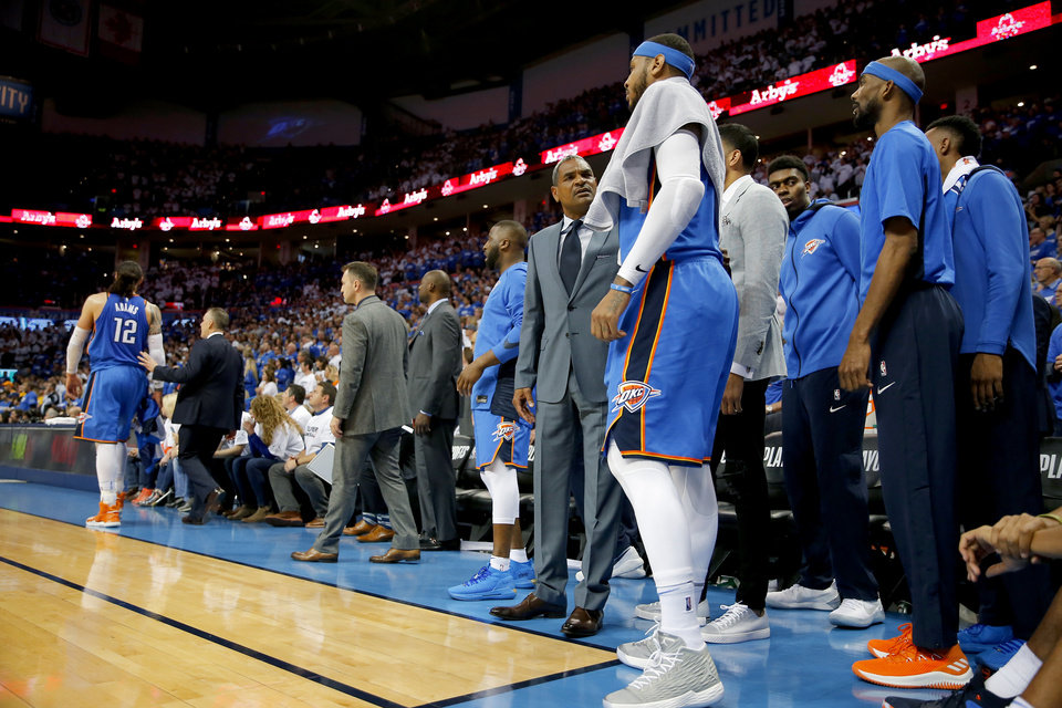 Photo -  Thunder assistant coach Maurice Cheeks talks to Carmelo Anthony on the sideline during Game 5 of the first-round playoff series against Utah. Anthony made it clear in his exit interview on Saturday that he does not want to play a bench role next season. [PHOTO BY BRYAN TERRY, THE OKLAHOMAN]