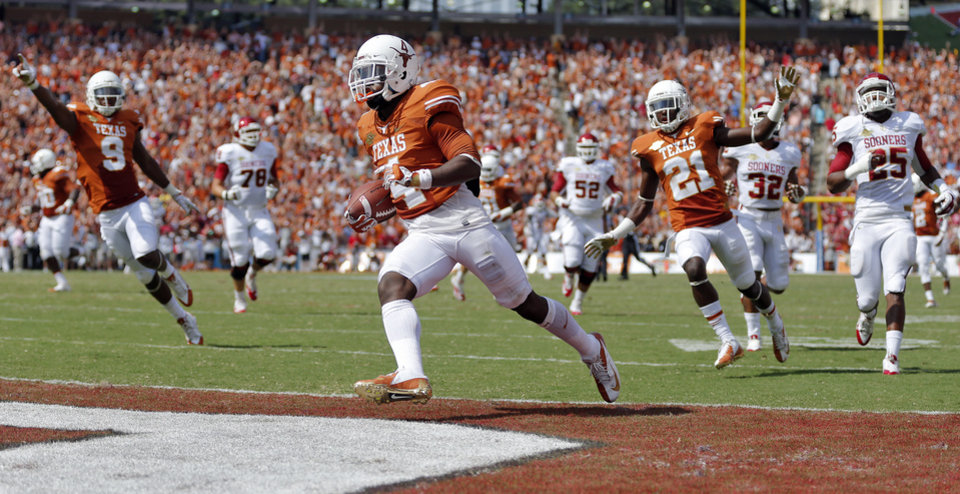 Photo - UT's Daje Johnson (4) runs into the end zone for a touchdown during the Red River Rivalry college football game between the University of Oklahoma Sooners (OU) and the University of Texas Longhorns (UT) at the Cotton Bowl Stadium in Dallas, Saturday, Oct. 12, 2013. Photo by Chris Landsberger, The Oklahoman