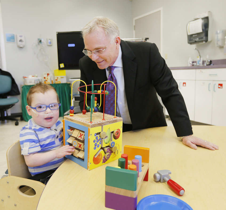 Albert Gray, chief executive of The Children's Center in Bethany, visits with Corban Walkup, 2, of Enid. Photo By Steve Gooch, The Oklahoman  <strong>Steve Gooch -   </strong>