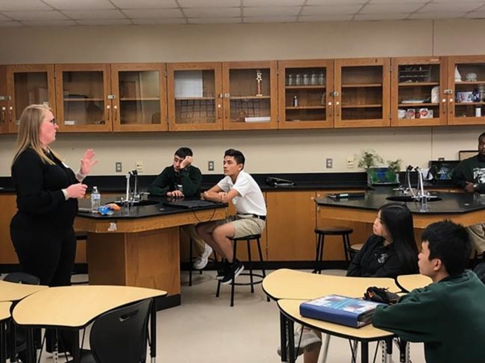 Photo -  Anne Emberson, a chemical engineer, explains what she does in her career to Harding Charter Prep students. [PROVIDED]