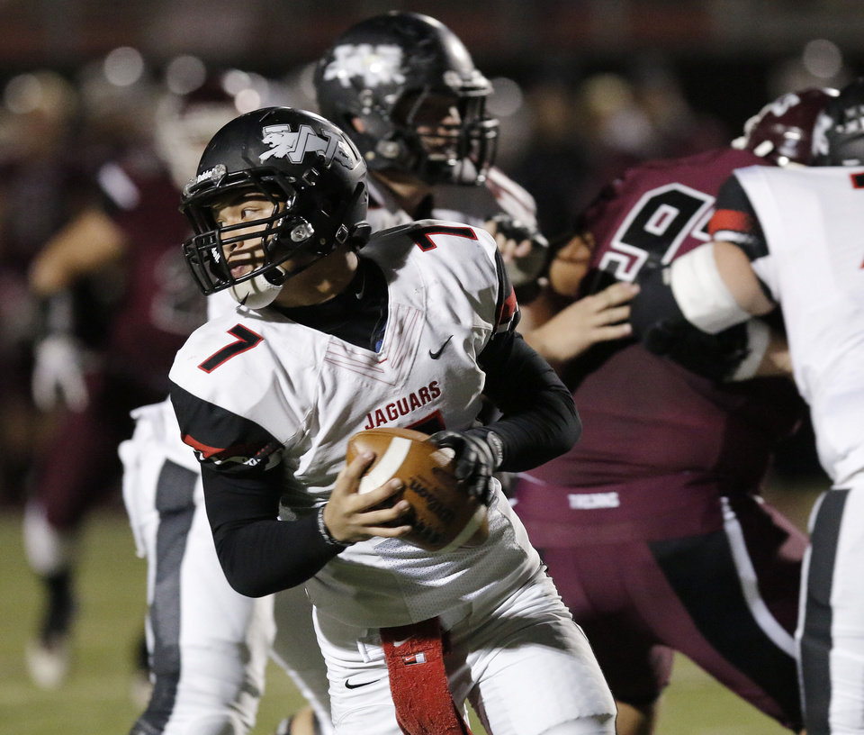 Photo - Westmoore quarterback Bryson Lee (7) runs out of pocket and ended up fumbling during the 6A high school playoff game between Westmoore and Jenks at Yukon High School Friday November 29, 2013. Photo by Doug Hoke, The Oklahoman