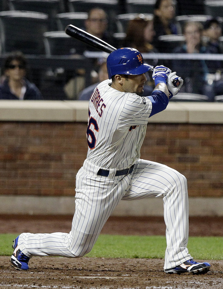 Photo -   New York Mets' Andres Torres hits an RBI single during the third inning of a baseball game against the Arizona Diamondbacks, Friday, May 4, 2012, in New York. (AP Photo/Frank Franklin II)
