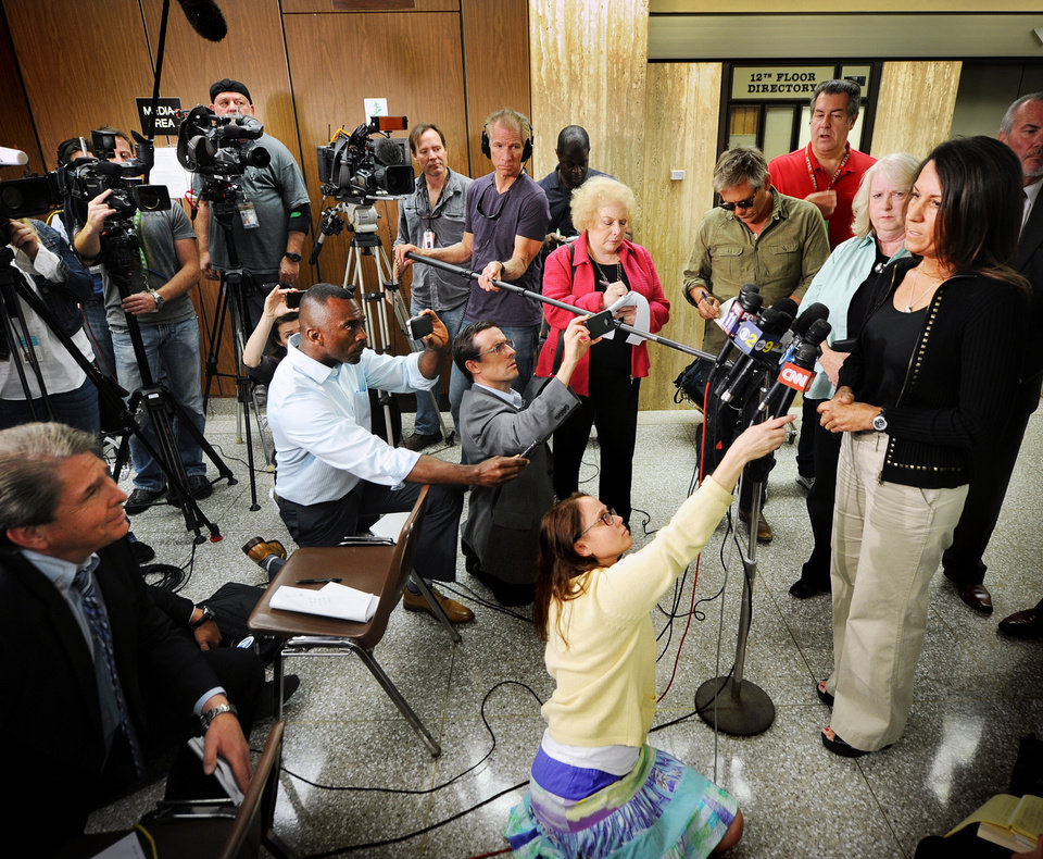 Photo - Ellen Sohus sister of murder victim John Sohus talks during a news conference after a jury found Christian Karl Gerhartsreiter guilty of first-degree murder in the 1985 San Marino killing on Wednesday, April 10, 2013 in  Los Angeles. The verdict was reached Wednesday after the jury deliberated about a day.  Testimony in the cold-case trial of Gerhartsreiter focused on the discovery of the bones of John Sohus long after he and his wife disappeared from his mother's home in San Marino, a wealthy Los Angeles suburb.  The defendant, a German immigrant with delusions of grandeur, rented a cottage at the Sohus home in 1985 then disappeared about the same time as Sohus and his wife Linda who was never found.  (AP Photo/San Gabriel Valley Tribune,Walter Mancini ) MAGS OUT; NO SALES; MANDATORY CREDIT