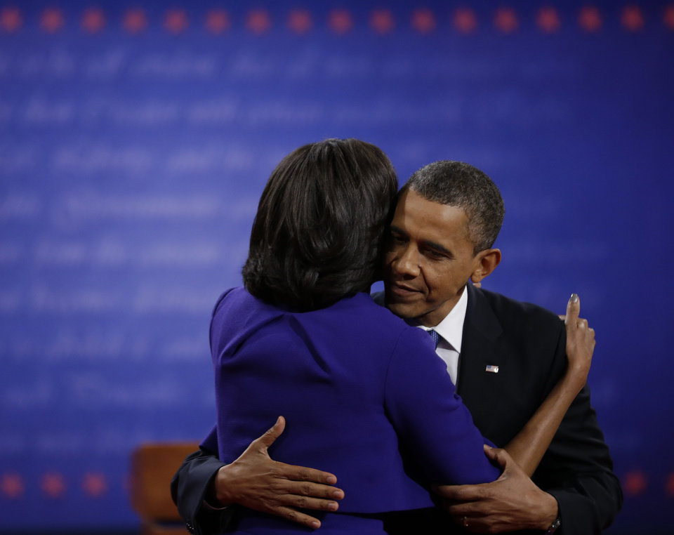 Photo -   President Barack Obama hugs his wife Michelle following the first presidential debate at the University of Denver, Wednesday, Oct. 3, 2012, in Denver. (AP Photo/David Goldman)