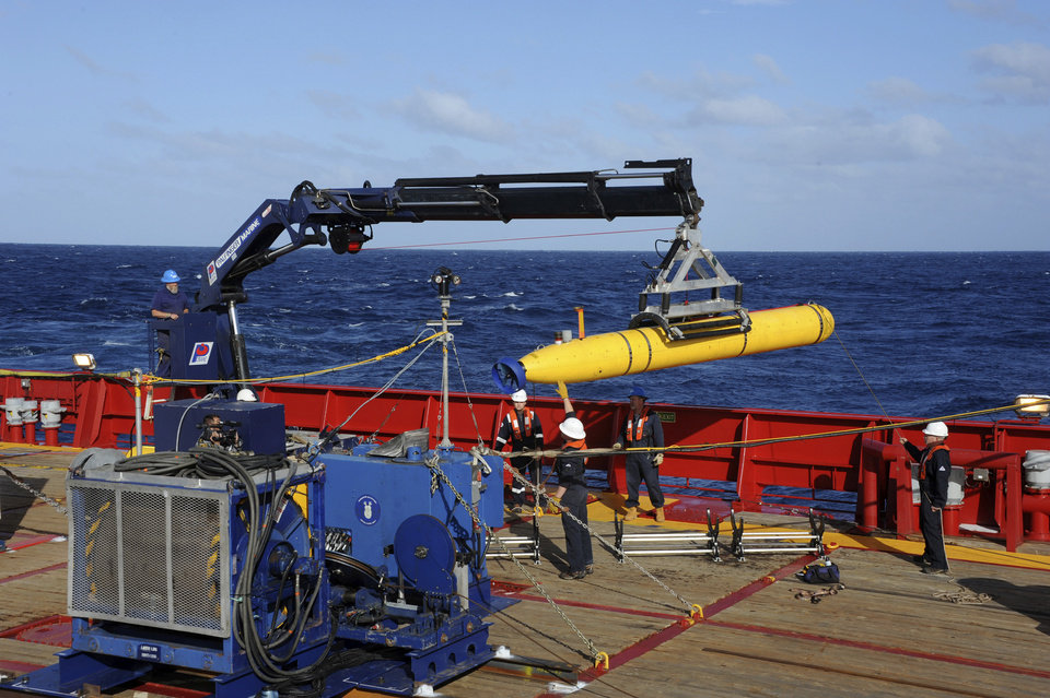 Photo - FILE - In this April 1, 2014 file photo, provided by the U.S. Navy, the Bluefin 21 autonomous sub is hoisted back on board the Australian Defense Vessel Ocean Shield after successful buoyancy testing in the Indian Ocean, as search efforts continue for missing Malaysia Airlines Flight 370. Search crews will send the sub deep into the Indian Ocean on Monday, April 14, 2014, for the first time to try to determine whether signals detected by sound-locating equipment are from the missing Malaysian plane's black boxes, the Australian head of the search said. Angus Houston said the crew on board the Ocean Shield will launch the underwater vehicle sometime Monday evening.  (AP Photo/U.S. Navy, Specialist 1st Class Peter D. Blair, File)