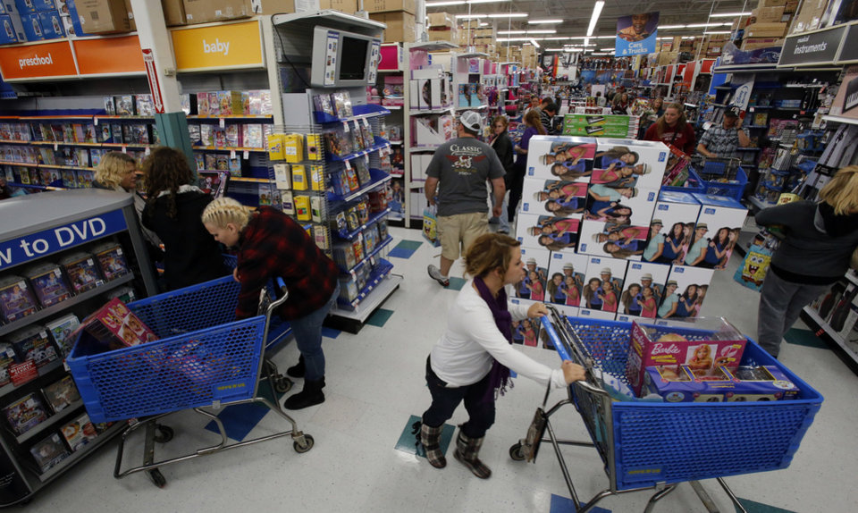 Bargain hunters shop at Toys R Us as they open at 8 p.m. for pre-Black Friday Sales on Thursday, Nov. 22, 2012, in Norman, Okla.  Photo by Steve Sisney, The Oklahoman