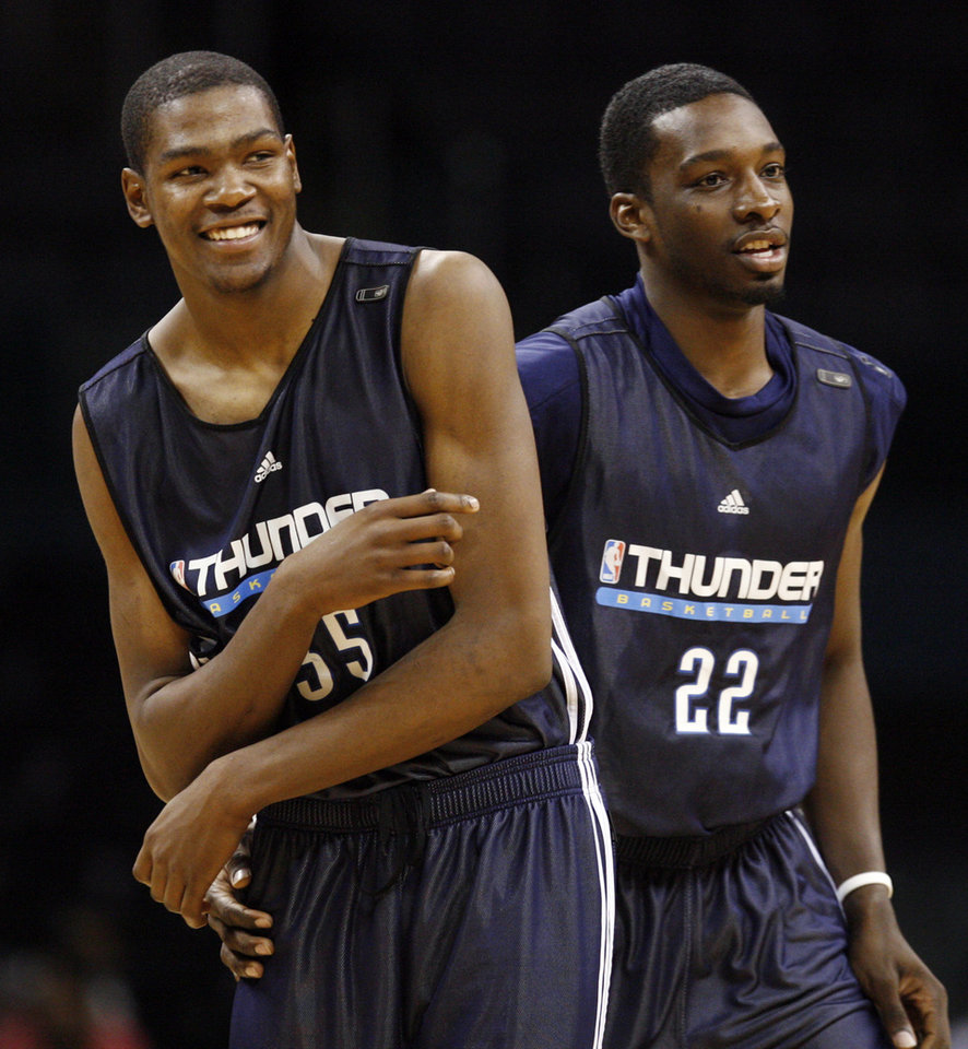 Photo - Kevin Durant, left, smiles next to Jeff Green during player introductions for the scrimmage at the open practice for the Oklahoma City Thunder NBA basketball team at the Ford Center in Oklahoma City, Monday, October 20, 2008. BY NATE BILLINGS, THE OKLAHOMAN