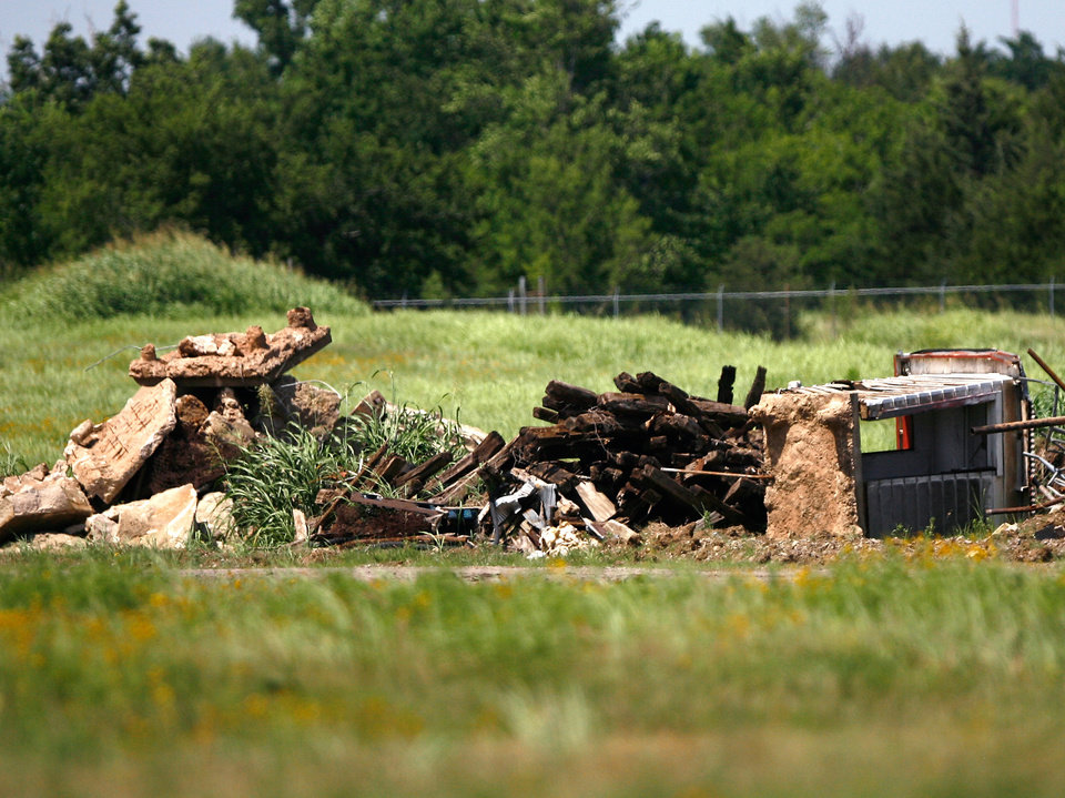 Old metal and debris are collected and stored in a pile at the front of the superfund site. Clean up is taking place at the Cushing, Okla Superfund site on Tuesday June 22, 2009. Photo by Mitchell Alcala, The Oklahoman ORG XMIT: KOD