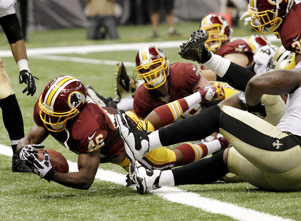 Photo -   Washington Redskins running back Alfred Morris (46) scores a touchdown in the second half of an NFL football game against the New Orleans Saints at the Mercedes-Benz Superdome in New Orleans, Sunday, Sept. 9, 2012. (AP Photo/Matthew Hinton)