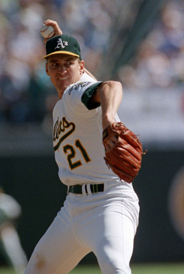 Photo -  Mike Moore pitches for the Oakland Athletics during the 1989 American League Championship Series against Toronto. [AP FILE PHOTO]