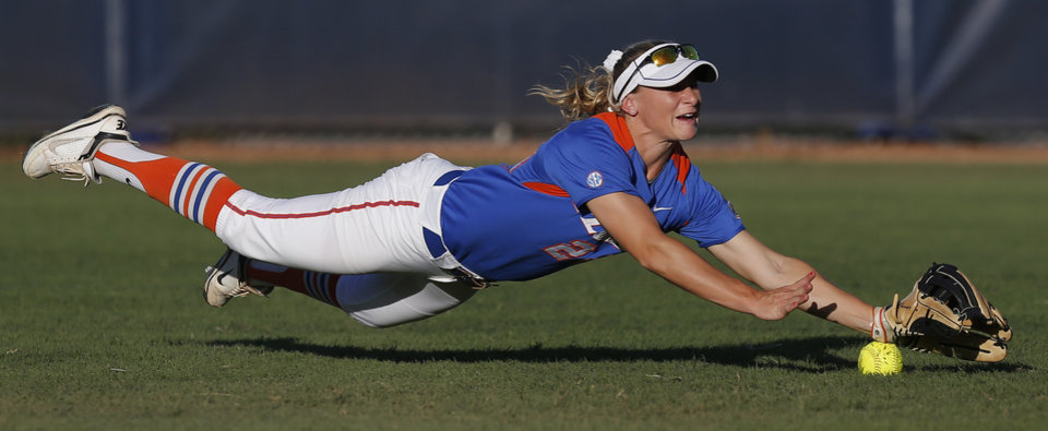 Florida's Kirsti Merritt misses the ball in the fourth inning against Nebraska during their during the Women's College World Series softball game at ASA Hall of Fame Stadium in Oklahoma City, Saturday, June, 1, 2013. Photo by Bryan Terry, The Oklahoman