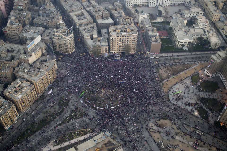 Photo - This aerial image made from an Egyptian army helicopter shows a general view of a pro-military rally marking the third anniversary of the uprising that toppled autocrat Hosni Mubarak in Tahrir Square in Cairo, Egypt, Saturday, Jan. 25, 2014. Egyptian riot police have fired tear gas to disperse hundreds of supporters of ousted Islamist President Mohammed Morsi protesting as the country marks the third anniversary of the 2011 uprising, as supporters of the military gathered in rival rallies in other parts of the capital, many of them urging military chief Gen. Abdel-Fattah el-Sissi, the man who removed Morsi, to run for president.(AP Photo/Hassan Ammar)