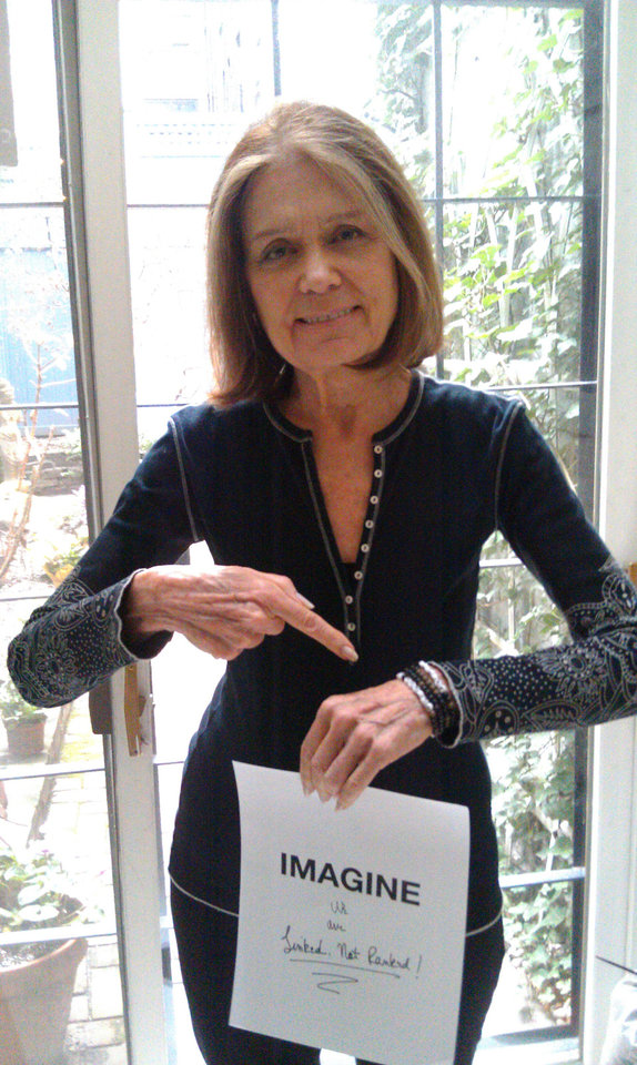 This undated photo provided by Maiden Nation shows Gloria Steinem wearing a bracelet she created for ImagiNation 365. Steinem, Yoko Ono and Lauren Bush are joining forces to give female empowerment a global boost. The campaign called ImagiNation 365 is led by Maiden Nation, an online social platform. Women around the world — including Ono, Steinem and Bush — created pieces of jewelry that express their vision of what is important to their nation. (AP Photo/Maiden Nation)