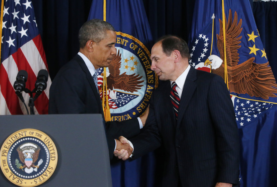 Photo - FILE - This June 2014 file photo shows President Barack Obama shaking hands with former Procter and Gamble executive Robert McDonald, his nominee as the next Veterans Affairs secretary, at the Department of Veterans Affairs in Washington.  A federal investigative agency says it is examining 67 claims of retaliation by supervisors at the VA against employees who filed whistleblower complaints. The independent Office of Special Counsel said 30 of the complaints about retaliation have passed the initial review stage and were being further investigated for corrective action and possible discipline against VA supervisors and other executives. The group's report comes as the Senate Veterans Affairs Committee holds a hearing Tuesday on the nomination of Robert McDonald to be VA secretary.  (AP Photo/Charles Dharapak)
