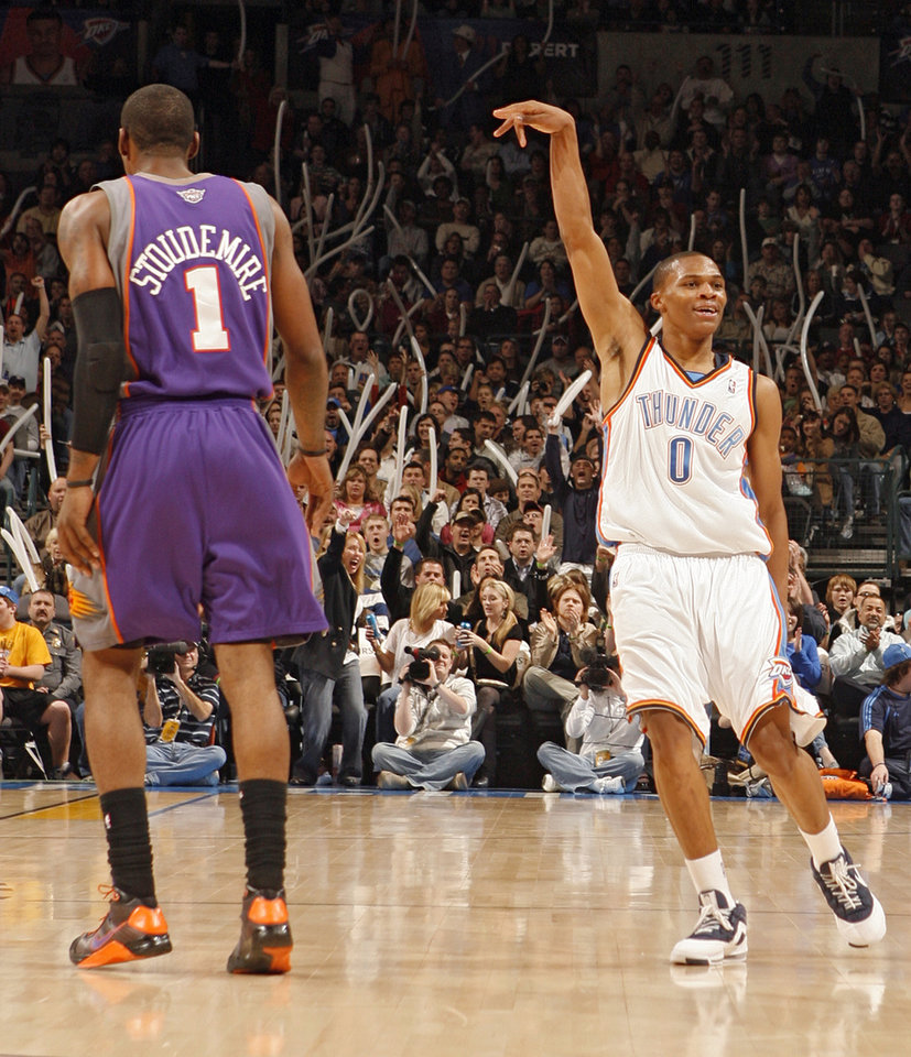 Photo - REACTION: Russell Westbrook (0) reacts after hitting a three-point shot in front of Phoenix's Amar'e Stoudemire (1) during the first half of the NBA basketball game between the Oklahoma City Thunder and the Phoenix Suns at the Ford Center on Monday, Dec. 29, 2008, in Oklahoma City, Okla.  Photo by CHRIS LANDSBERGER, THE OKLAHOMAN ORG XMIT: KOD