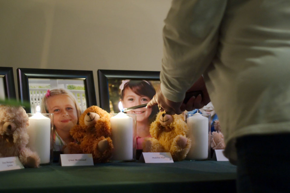 A candle is lit in memory of Madeleine Hsu during a vigil in Pearland, Texas Friday, Dec. 21, 2012.   (AP Photo/The Courier, Kirk Sides) ORG XMIT: NY926