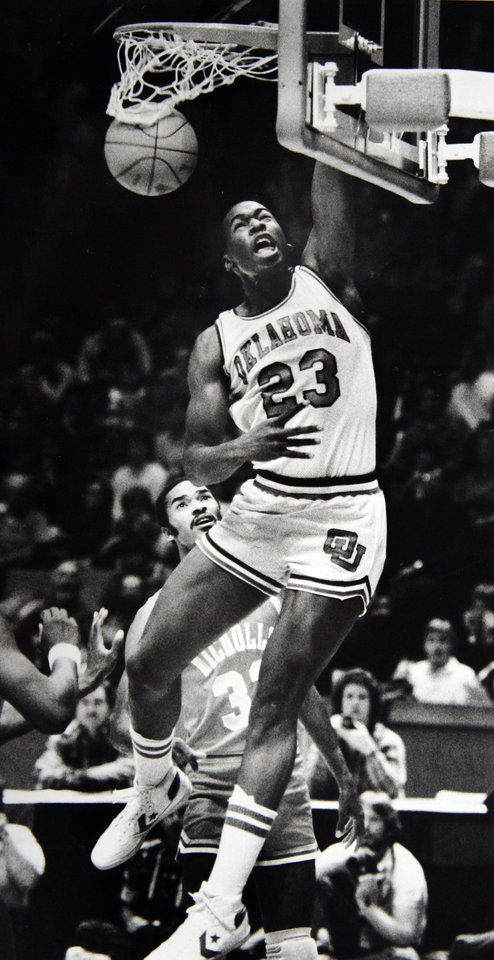 Former OU basketball player Wayman Tisdale. OU\'s Wayman Tisdale makes sure on this basket, scoring two of his game-high 36 points. Staff Photo by Doug Hoke. Photo taken 1/14/1984, Photo published 1/15/1984, 3/15/1984 in The Daily Oklahoman. ORG XMIT: KOD