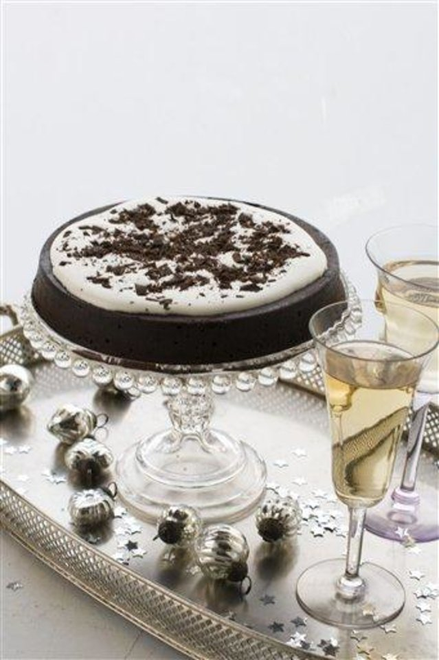 Photo - In this image taken on Nov. 26, 2012 a flourless chocolate cake is shown served on a cake stand in Concord, N.H. (AP Photo/Matthew Mead)