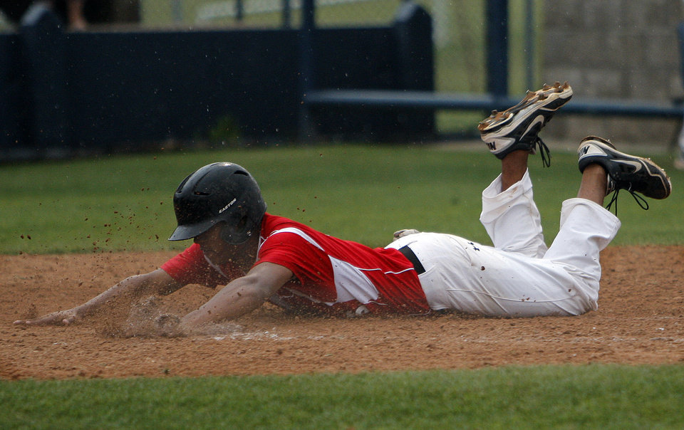 Photo - Hilldale's Miles Jackson slides into home during the 4A high school baseball playoff game between Hilldale and Anadarko at Shawnee High School in Shawnee, Okla., Friday, May 11, 2012. Photo by Sarah Phipps, The Oklahoman
