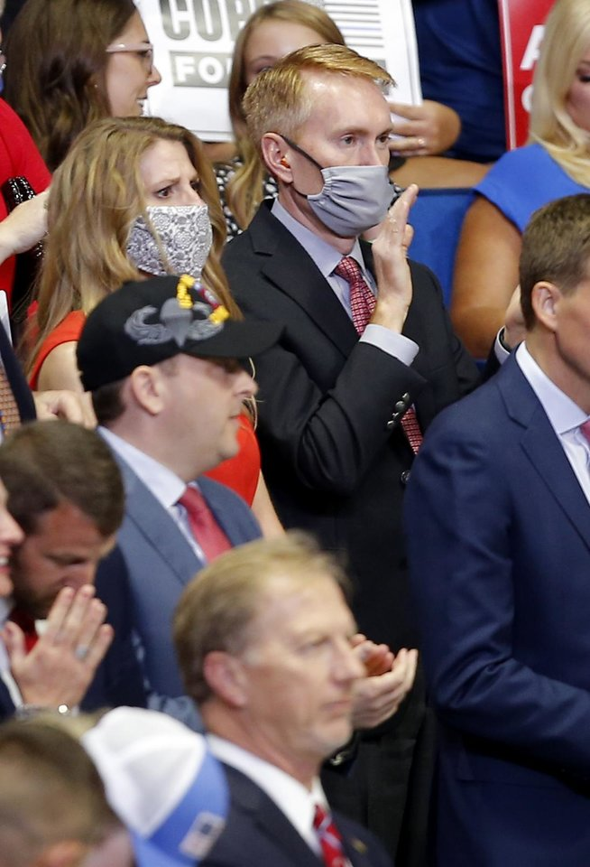 Photo - U.S. Senator James Lankford claps during the President Donald Trump rally at the BOK Center in Tulsa, Okla., Saturday, June 20, 2020. [Sarah Phipps/The Oklahoman]