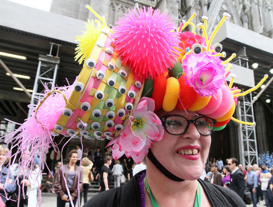 Photo -   Wearing a hat made with plastic puppet eyes, Leslie Lowe, of New York, poses for photographs as she takes part in the Easter Parade along New York's Fifth Avenue Sunday, April 24, 2011. (AP Photo/Tina Fineberg)