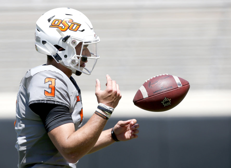 Photo - Oklahoma State's Spencer Sanders (3) prepares for throwing drills during the Oklahoma State Cowboys spring practice at Boone Pickens Stadium in Stillwater, Okla., Saturday, April 20, 2019.  Photo by Sarah Phipps, The Oklahoman
