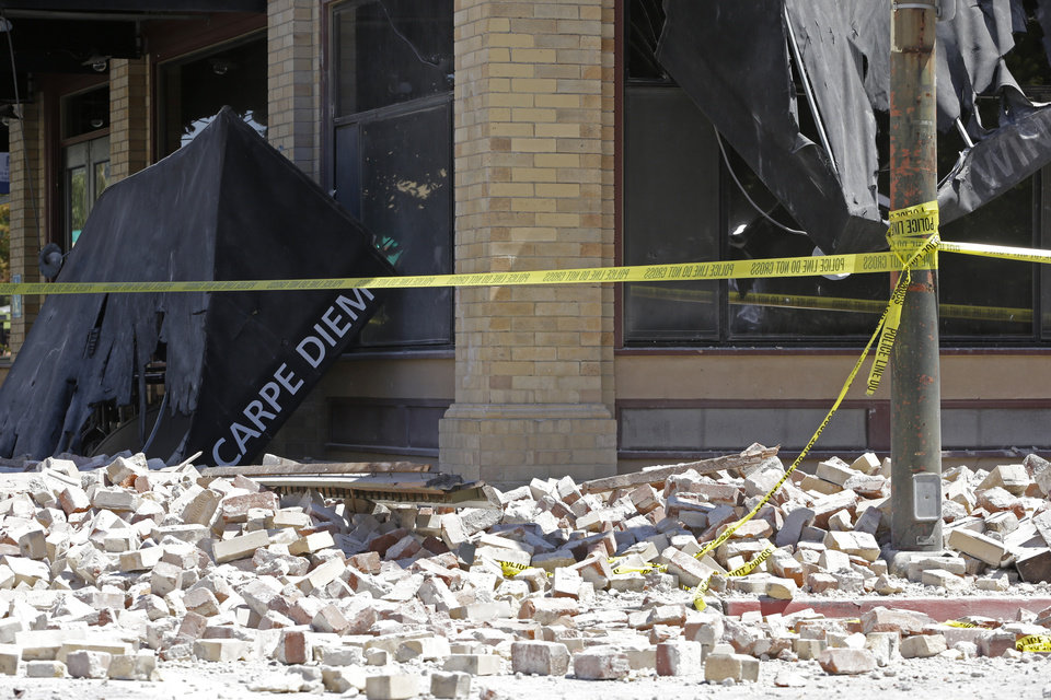 Photo - Rubble litters Main Street after an earthquake struck Sunday, Aug. 24, 2014, in Napa, Calif. Officials say an earthquake with a preliminary magnitude of 6.0 has been reported in California's northern San Francisco Bay area. (AP Photo/Ben Margot)