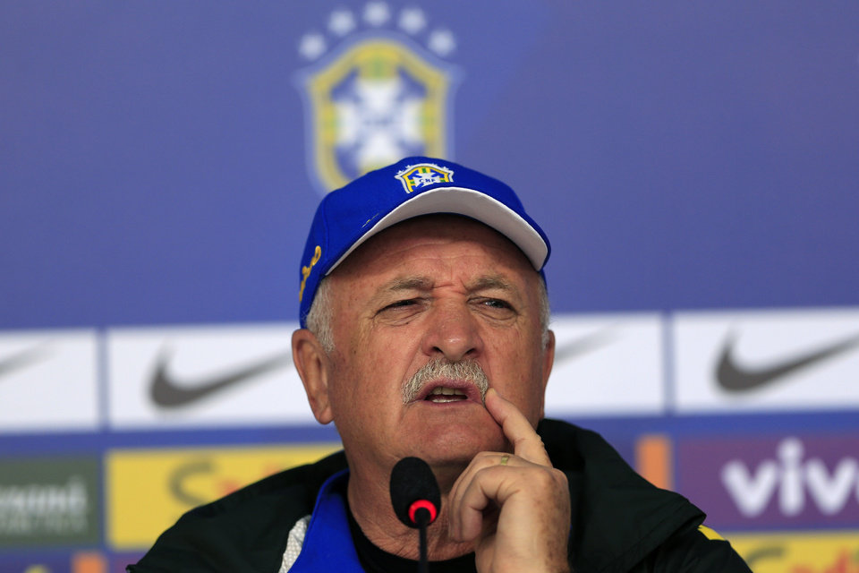 Photo - Brazil's coach Luiz Felipe Scolari answers questions during a press conference at the Granja Comary training center in Teresopolis, Brazil, Thursday, June 5, 2014. Brazil will face Croatia at the opening match of the World Cup soccer tournament on June 12. (AP Photo/Hassan Ammar)