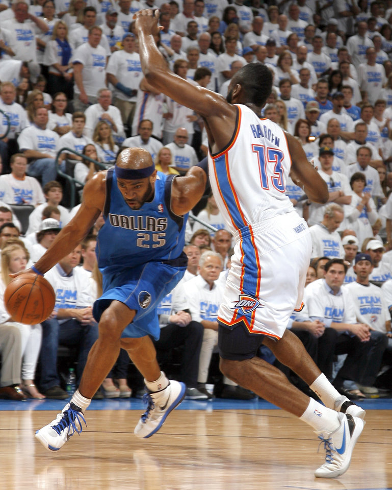 Dallas\' Vince Carter (25) drives past Oklahoma City\'s James Harden (13) during Game 2 of the first round in the NBA basketball playoffs between the Oklahoma City Thunder and the Dallas Mavericks at Chesapeake Energy Arena in Oklahoma City, Monday, April 30, 2012. Photo by Sarah Phipps, The Oklahoman