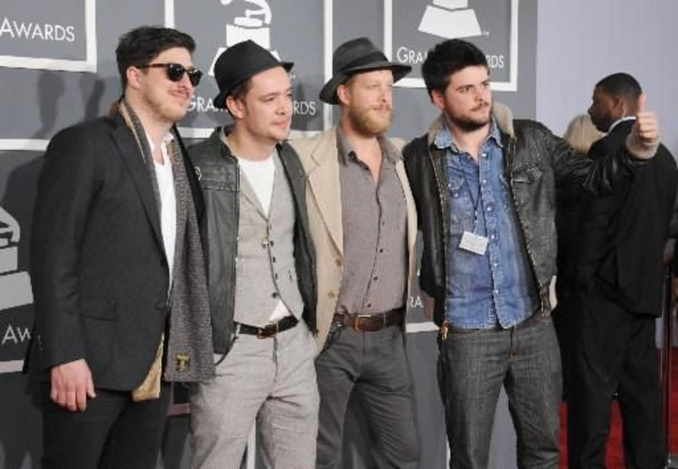 From left, Marcus Mumford, Ben Lovett, Country WInston and Ted Dwane, of musical group Mumford & Sons, arrive at the 55th annual Grammy Awards on Sunday, Feb. 10, 2013, in Los Angeles. (AP)
