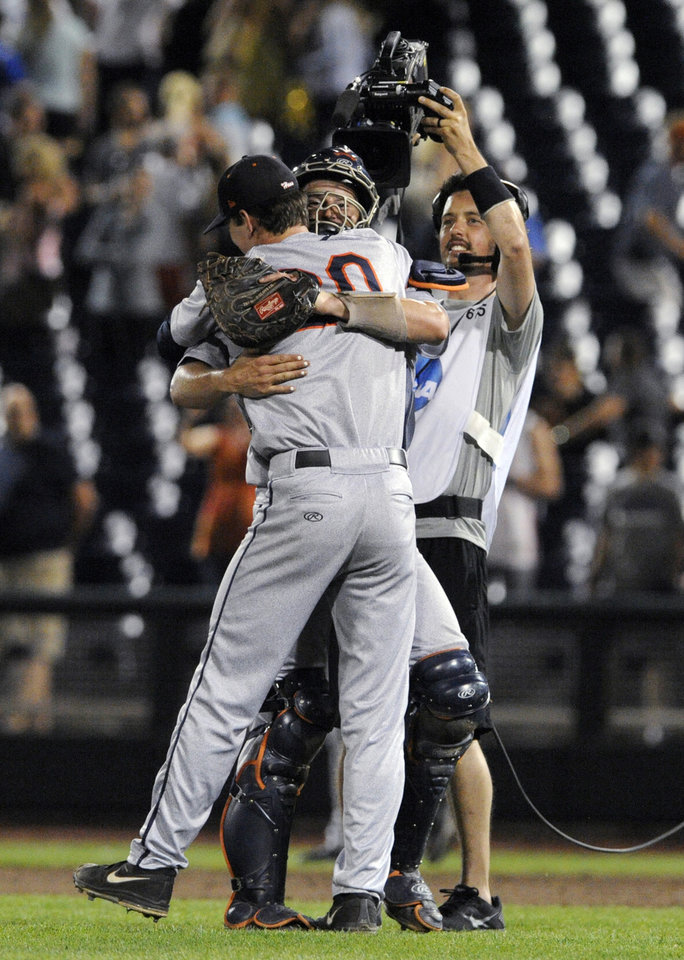 Photo - Virginia pitcher Brandon Waddell (20) celebrates with catcher Robbie Coman after Virginia defeated Vanderbilt 7-2 in Game 2 of the best-of-three NCAA baseball College World Series finals in Omaha, Neb., Tuesday, June 24, 2014. (AP Photo/Eric Francis)