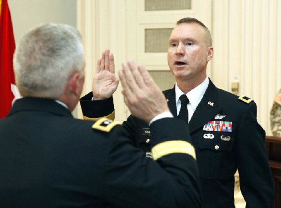 Photo - Brigadier General Walter Fountain takes his Officer Oath administered by Major General Myles Deering, during a pinning ceremony at the State Capitol in Oklahoma City, OK, Friday, Dec. 2, 2011. By Paul Hellstern, The Oklahoman ORG XMIT: KOD